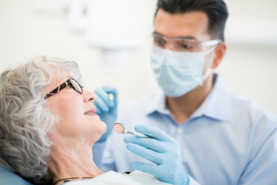 Dentist examining older patient  mature  senior  elderly  dentist